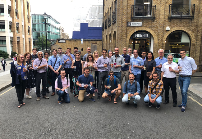 Men and women posing for a group photo in London