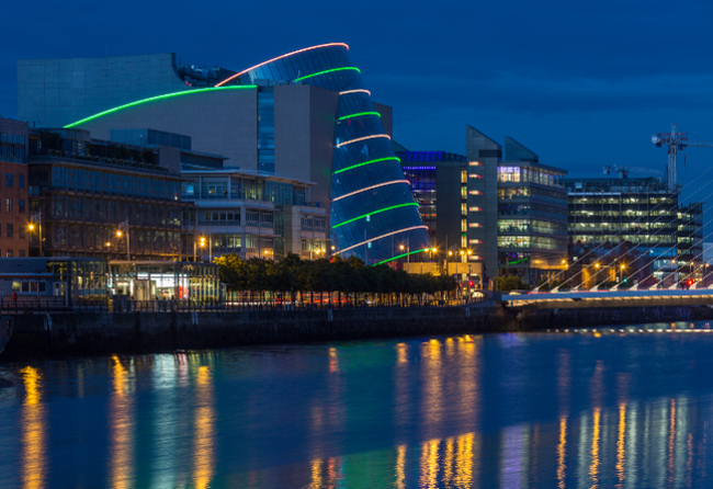 Nightime shot with electric illumination, along the River Liffey and the building on the waterfront near the Convention Centre - Dublin city center in the republic of Ireland.