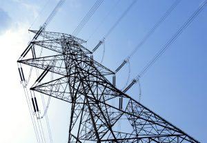 Electricity pylon on blue sky