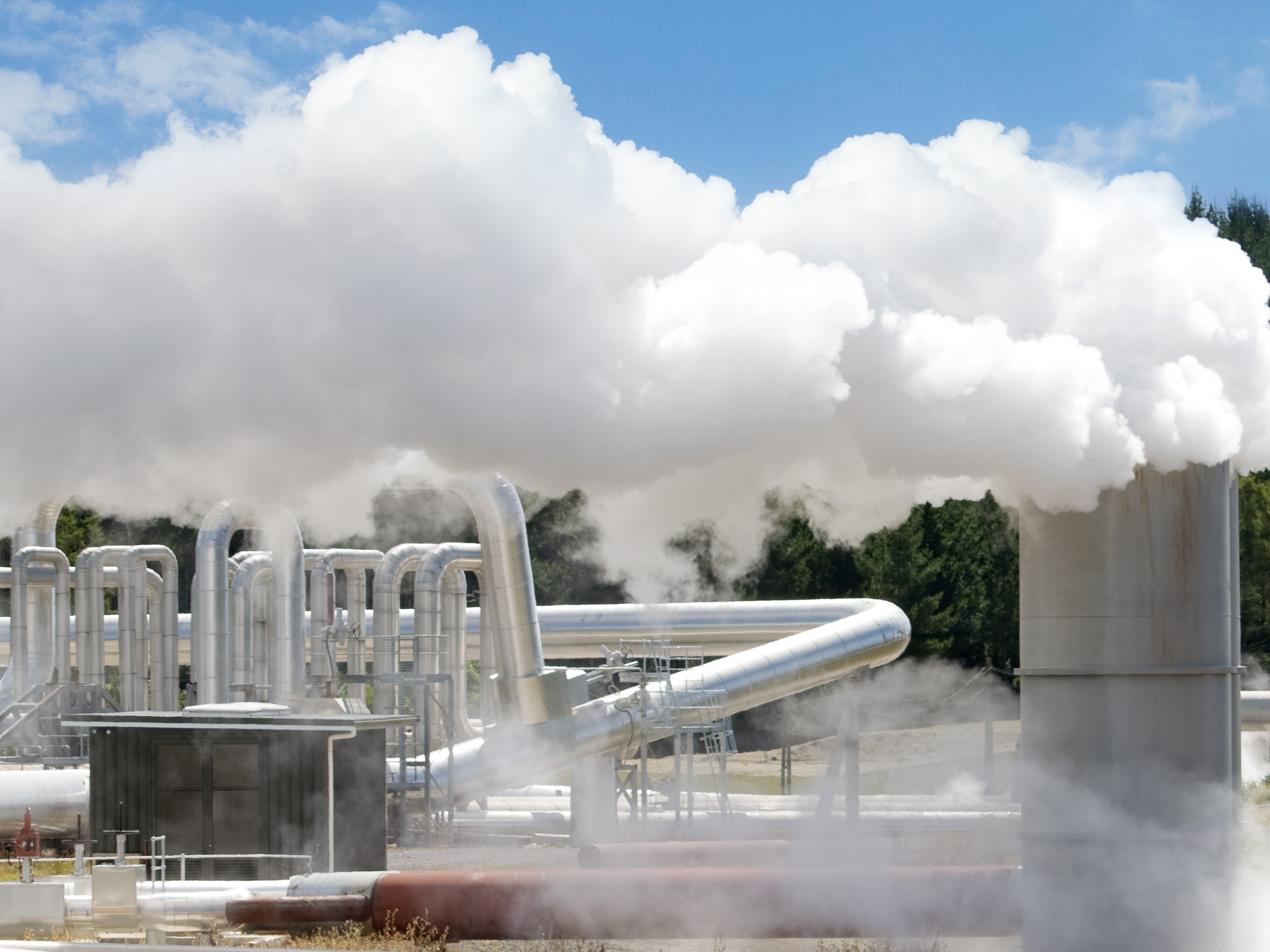 Geothermal enery plant, clouds of steam from chimeney