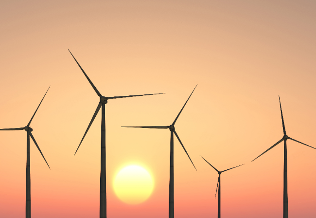 Sunset image with sun and wind turbine silhouettes
