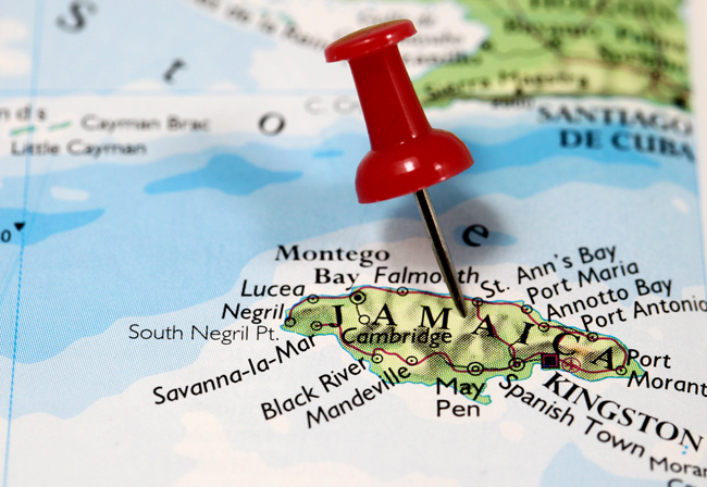 Map of Jamaica, in the Caribbean. Red map pin attached to Jamaica to illustrate this country is featured.