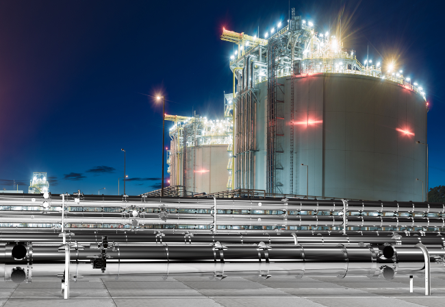 Night time shot of LNG terminal with gas pipelines