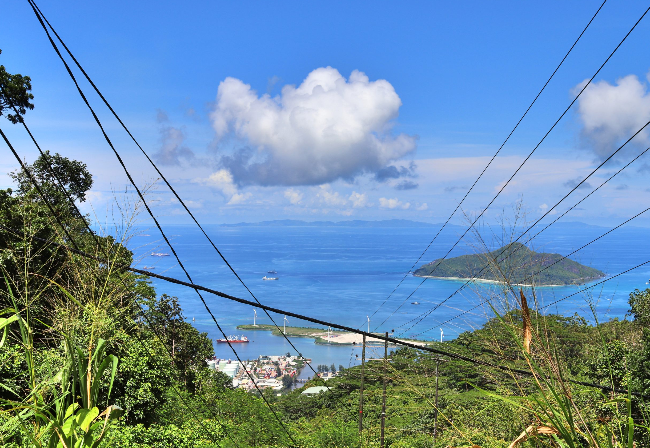 electricity lines over harbour with sea view
