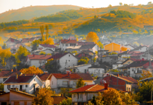 shot of rural Macedonia with village in foreground and hilly fields behind
