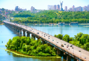 Kiev City in background with river and bridge with road traffic in the foreground