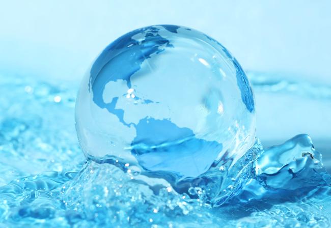 glass world globe in blue water