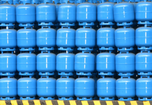 blue gas cylinders piled high
