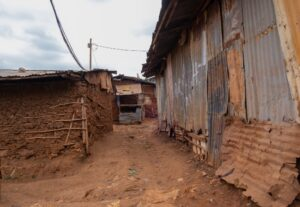 Close up inside a Kenyan village with solitary powerline feeding electricity