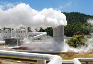 close up of geothermal plant with steam billowing
