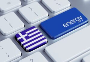 keyboard with one key showing the Greek flag, the second showing the word energy